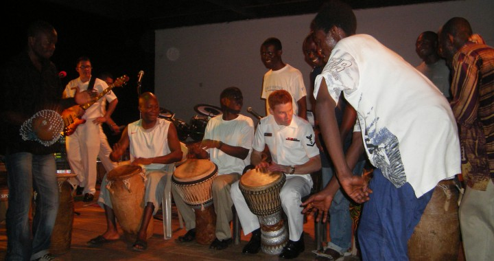 MU2 Christopher Cancelliere performing with a Ghanaian drummers
