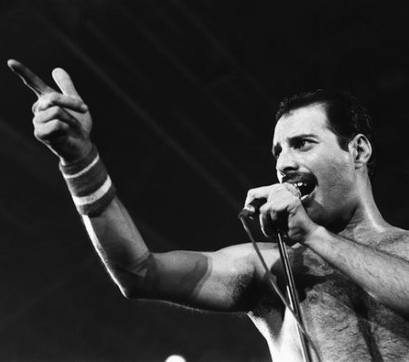 Freddie Mercury performing live show