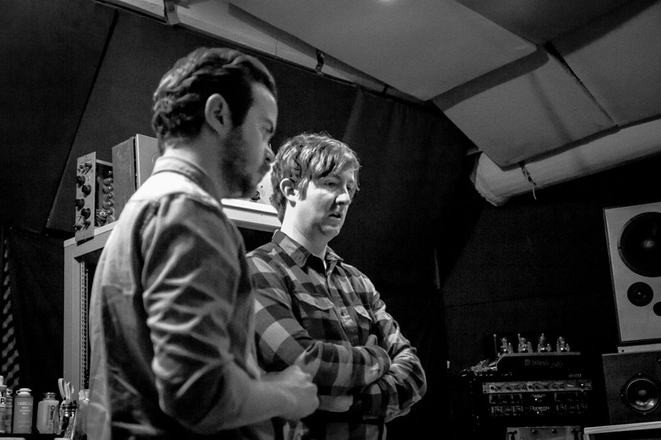 Tim and Charlie listening back